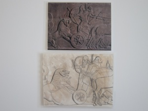 Gypsum wall panel relief showing Ashurnasirpal II hunting lions; 865BC-860BC; Neo-Assyrian