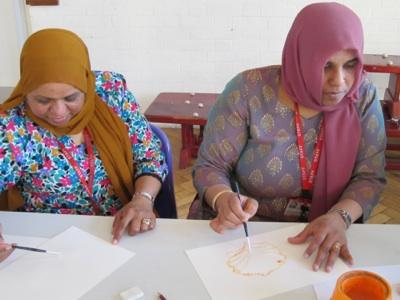 Members of teaching staff painting